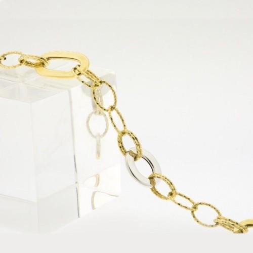 Pulsera de anillas en oro bicolor